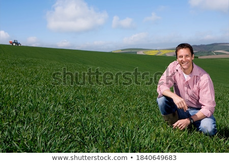 farmer kneeling by crops stock photo © photography33
