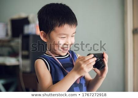 jovem · criança · câmera · digital · digital · câmera · cinza - foto stock © gewoldi