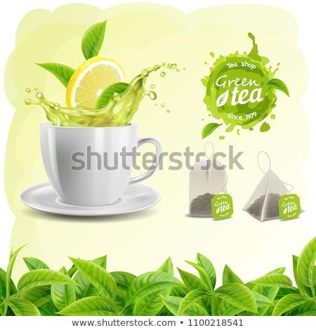 Beker groene thee splash geïsoleerd licht leven Stockfoto © shutswis