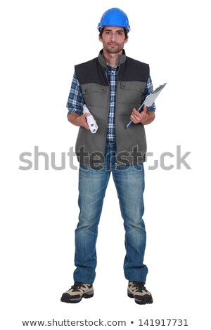 Tradesman holding up a rolled-up blueprint Stock photo © photography33