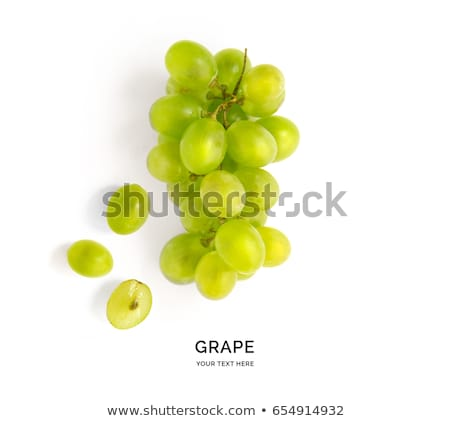 bunch of green grapes laying isolated stock photo © bloodua