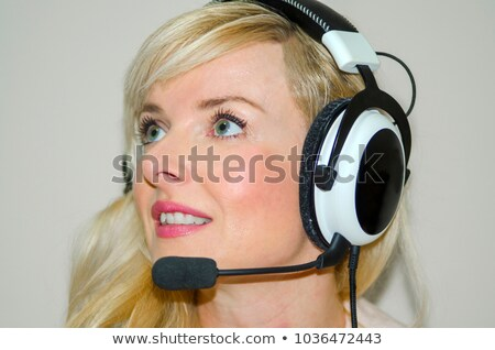 pretty female operater with headphones Stock photo © imarin