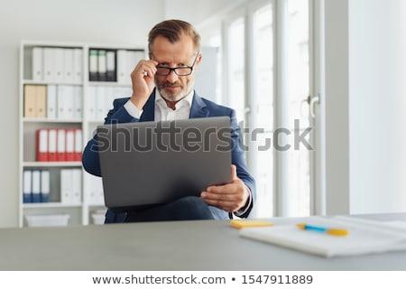 Man peering at his laptop Stock photo © photography33