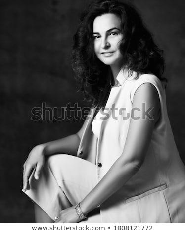 Jonge charmant vrouw zwarte leggings geïsoleerd Stockfoto © acidgrey