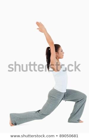 Nyugodt fiatal nő gyakorol jóga fehér fitnessz Stock fotó © wavebreak_media