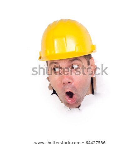 craftsman looking through a hole in a paper wall stock photo © photography33