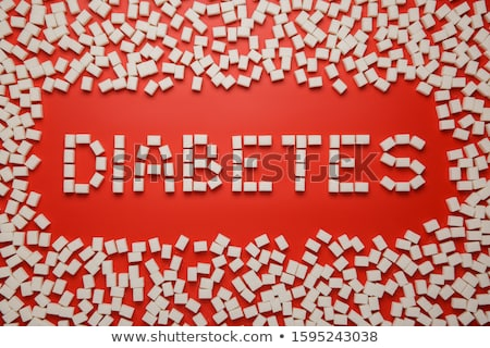 Stock photo: Sugar lumps and word diabetes