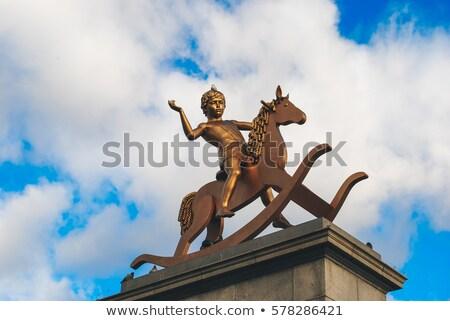 Boy on Rocking Horse Statue in Trafalgar Square Stock photo © chrisdorney