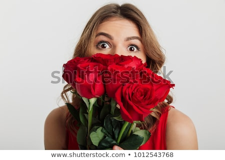 woman holding bouquet of flowers over her face stock photo © dolgachov