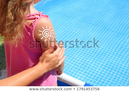 Daughter and mother on the beach sun screen moisture Stock photo © lunamarina