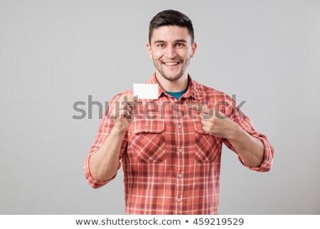 üzletember mutat üres kártya üzlet iroda hirdetés Stock fotó © dolgachov