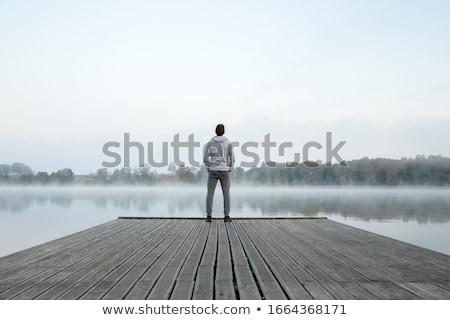 Férfi zaklatott álmodozás közelkép portré fiatalember Stock fotó © ichiosea