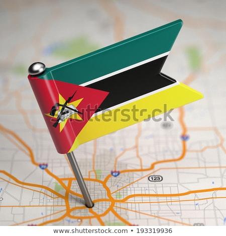 Mozambique Small Flag on a Map Background. Stock photo © tashatuvango