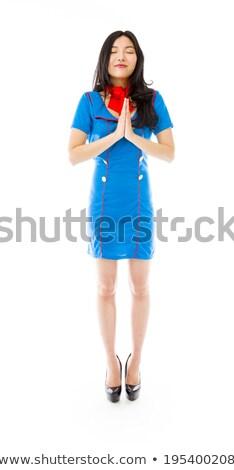 asian air stewardess praying stock photo © bmonteny