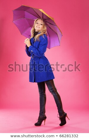 Cheerful blonde lady with the pink umbrella Stock photo © majdansky