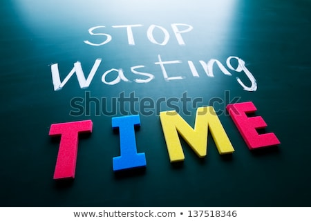 text on blackboard with money   stop wasting money stock photo © zerbor