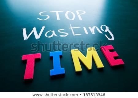 Text on blackboard with money - Stop wasting money Stock photo © Zerbor