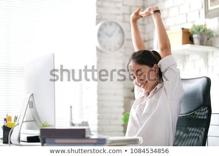 Businesswoman on office chair Stock photo © cherezoff
