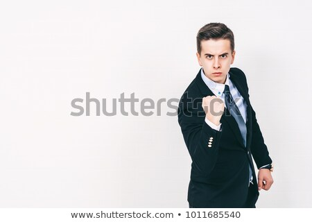 business man shwoing fist stock photo © fuzzbones0