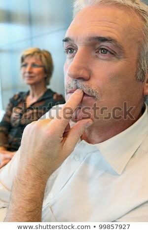 Business man hook on something Stock photo © fuzzbones0
