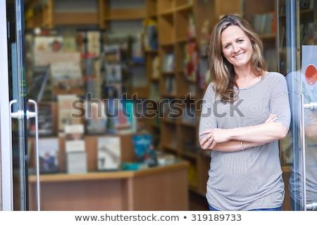 Retrato feminino livraria proprietário negócio livro Foto stock © HighwayStarz