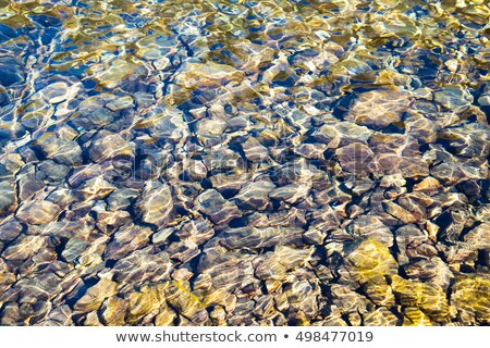 Pebbles seen through clear water Stock photo © master1305
