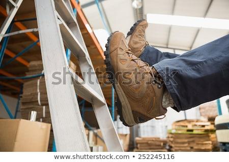 Worker falling off ladder in warehouse Stock photo © wavebreak_media