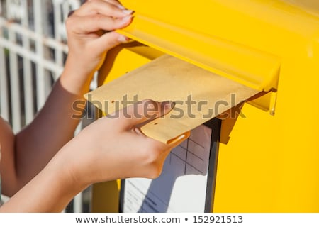 Woman's Hands Inserting Letter In Mailbox Stock photo © AndreyPopov