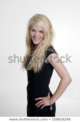 Amazed pretty young woman in black dress  Stock photo © deandrobot