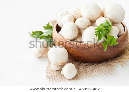 setas · foto · delicioso · crudo · tabla · de · cortar · bordo - foto stock © oleksandro