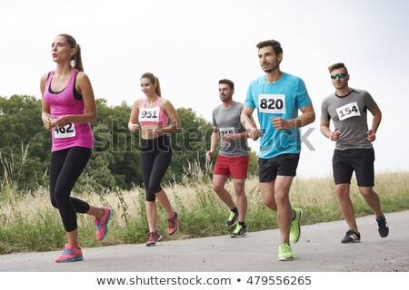 Man chasing a number Stock photo © bluering
