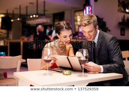Young romantic couple reading the menu Stock photo © dash
