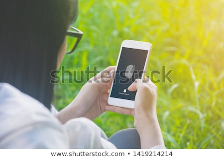 Unlocking smartphone with fingerprint scan sensor Stock photo © stevanovicigor