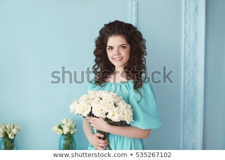 Happy smiling teen brunette with white roses bunch of flowers in Stock photo © Victoria_Andreas
