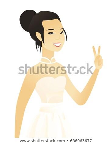 Asian verloofde tonen overwinning gebaar teken Stockfoto © RAStudio