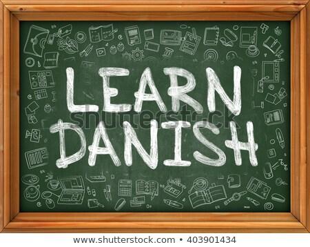 hand drawn learn danish on green chalkboard stock photo © tashatuvango