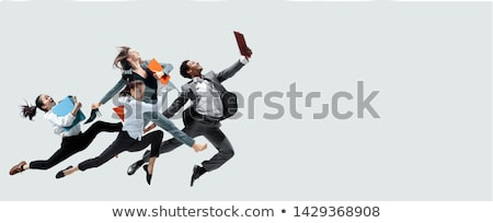 Office worker jumping in office Stock photo © IS2