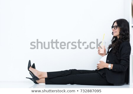 pregnant businesswoman drinking milkshake Stock photo © LightFieldStudios