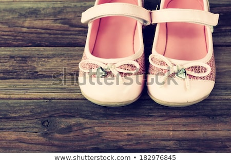 Childrens shoes on wooden decking Stock photo © IS2