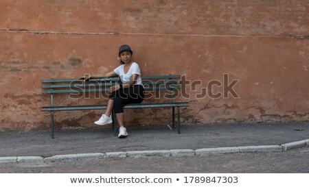 young woman in short pants posing with legs crossed stock photo © feedough