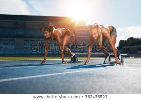 2 female athletes sprinting away Stock photo © IS2