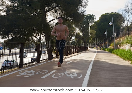 Bare chested man running in sunlight Stock photo © IS2