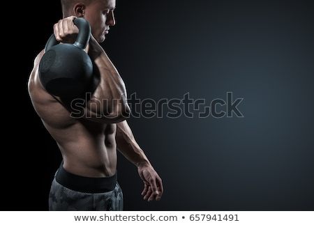 Cropped image of a muscular strong male bodybuilder Stock photo © deandrobot