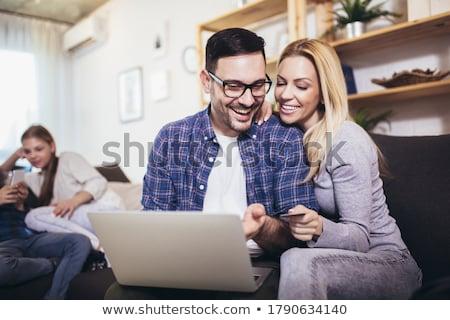 casal · digital · comprimido · sorridente · branco - foto stock © wavebreak_media