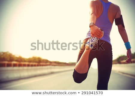 Stock photo: Sporty woman stretching before running or exercising by the sea