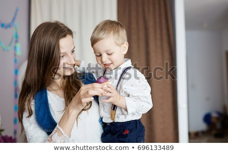 Portrait of smiling father and son having muffin at home Stock photo © wavebreak_media