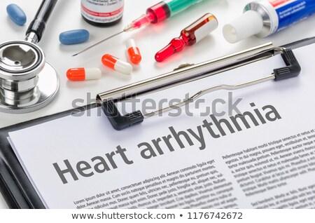 the text heart arrythmia written on a clipboard stock photo © zerbor