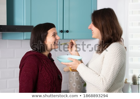 Gay People Having Breakfast Cooking In Home Kitchen Stock photo © diego_cervo