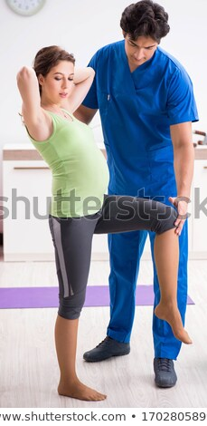 pregnant woman doing physical exercies with instructor stock photo © elnur