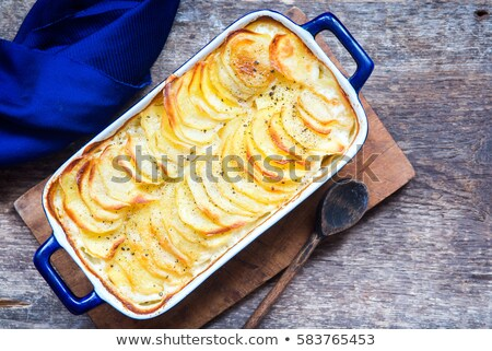 rustic golden scalloped potato gratin dauphinois Stock photo © zkruger